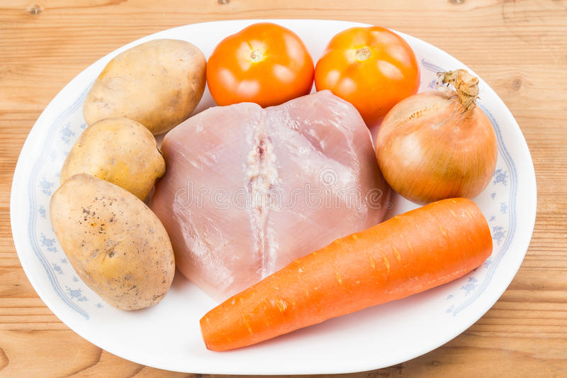 Ingredients to double boil Chinese potatoes, carrots, tomatoes soup.  stock photo