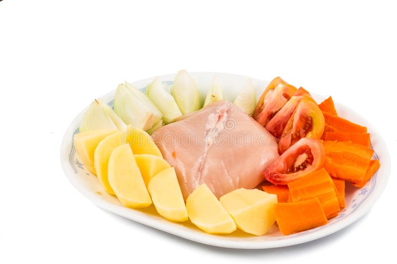 Ingredients to double boil Chinese potatoes, carrots, tomatoes soup.  royalty free stock photos