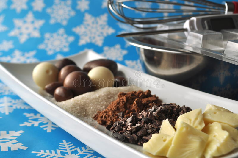Download Ingredients And Tools For Making Chocolates On Winter Background With Snow Flakes Stock Photo - Image: 83724576