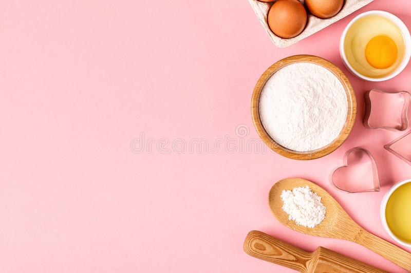 Ingredients and utensils for baking on a pastel background. stock images