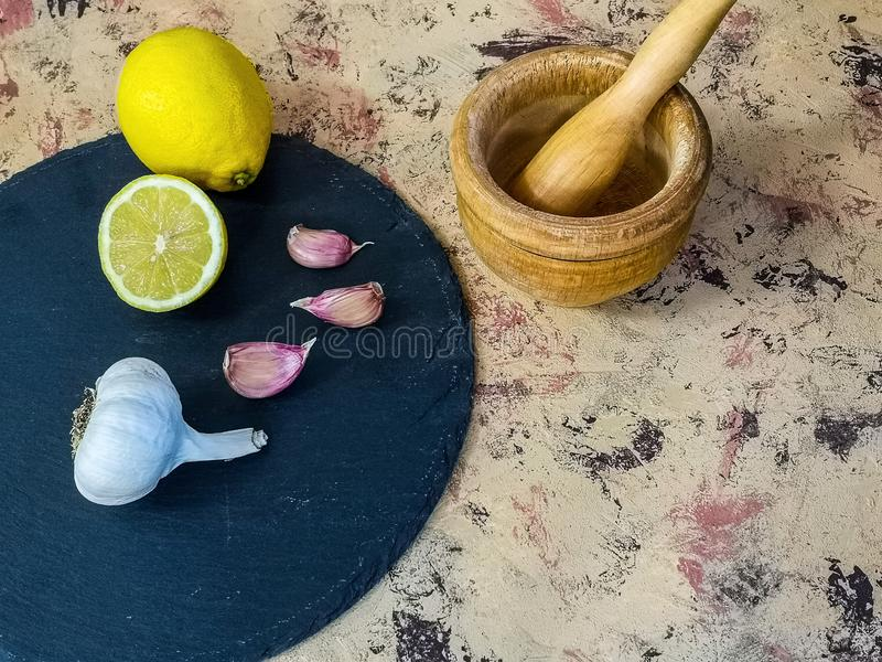 Ingredients and utensils to make mayonnaise with garlic in composition royalty free stock image