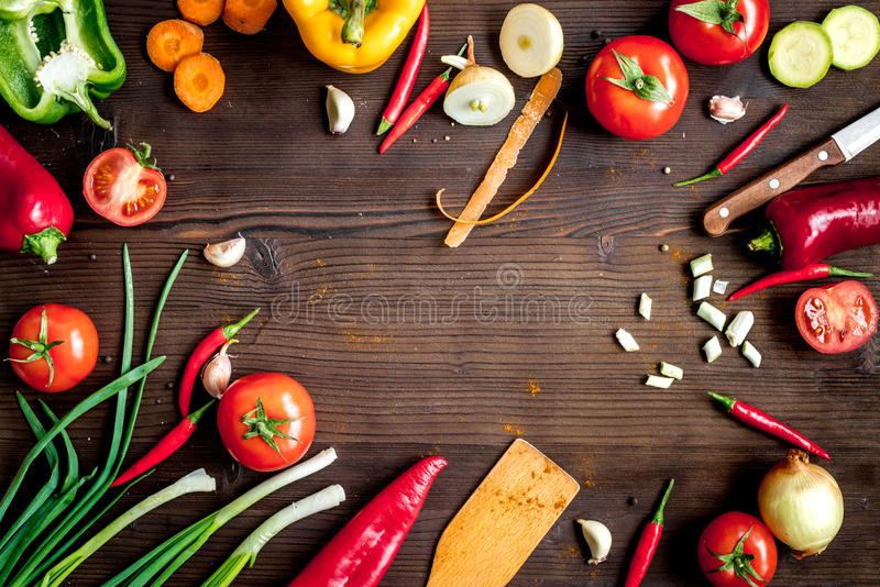 Ingredients for vegetable ragout on wooden background top view stock photos