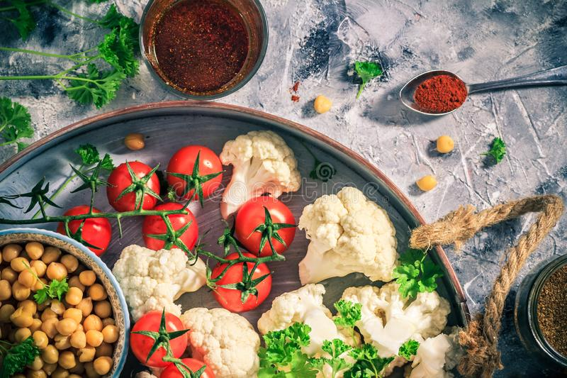 Ingredients vegetarian dish cauliflower baked chickpeas tomatoes stock image