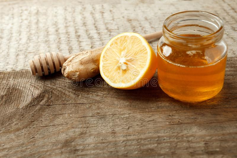 Ingredients for herbal medicine lemon, ginger, honey. Natural products to support the immune system in winter, vintage wooden back royalty free stock photos
