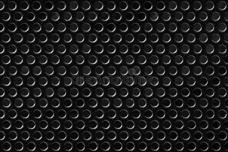 Ingrepp för texturmetallsvart med runda hål royaltyfria bilder