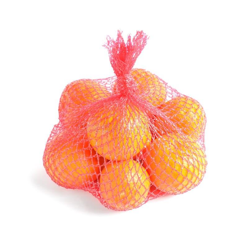 Ingreppspåse med tangerin på vit royaltyfri fotografi