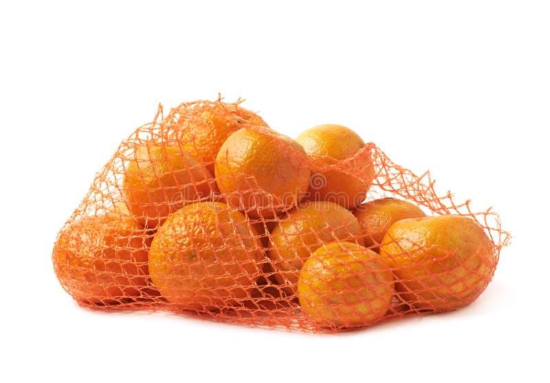 Ingreppspåse mycket av isolerade tangerin royaltyfria foton