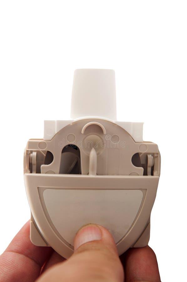 Inhalateur d'asthme de poudre en main photos stock