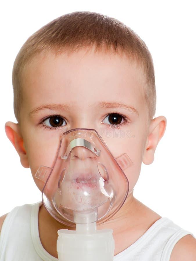inhalation av maskeringen arkivbild