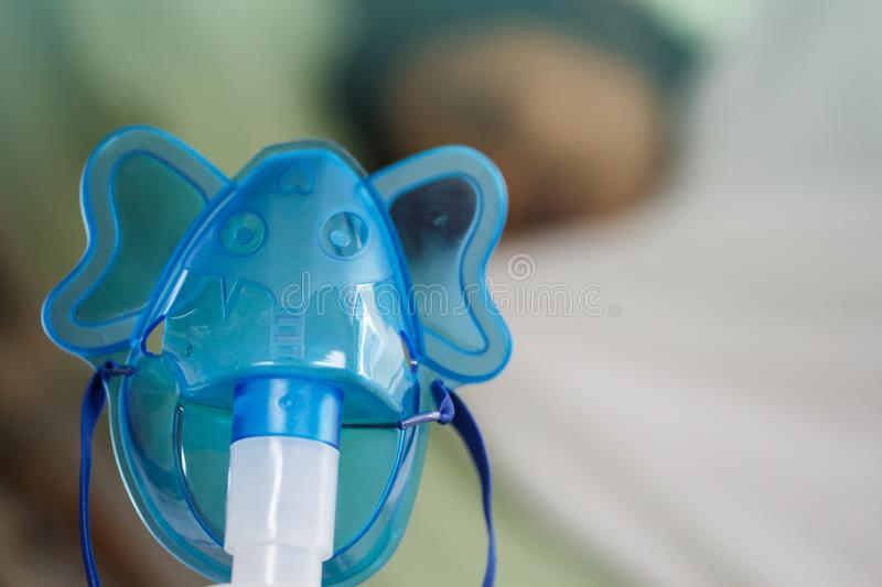 Inhalation mask with blurred patient stock images