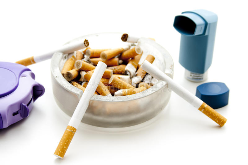 Inhaler with cigarets and ashtray. On white background royalty free stock photos