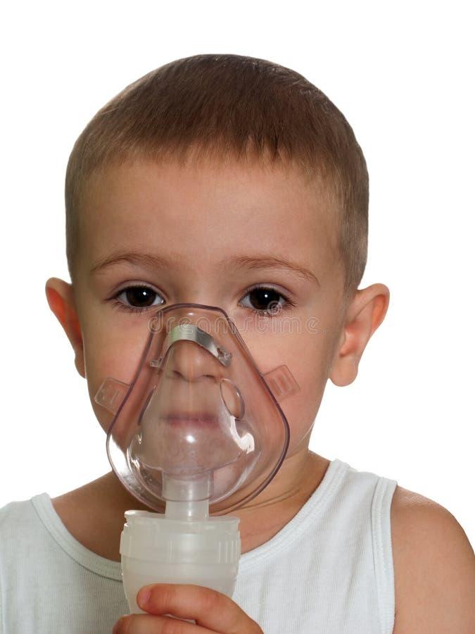 Inhaling mask royalty free stock photography