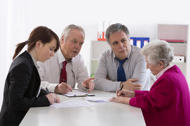 Inheritance counselor meeting with Senior woman. Inheritance counselor meeting with Senior women about her last will stock photography