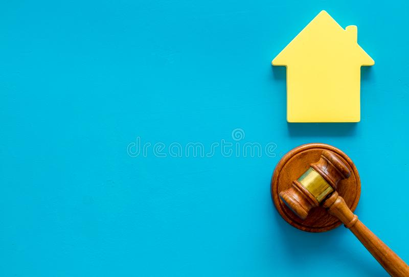 Inheritance of the house concept with figure and gavel on blue background top view space for text. Inheritance of the house concept with house figure and stock photos