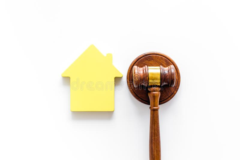 Inheritance of the house concept with figure and gavel on white background top view. Inheritance of the house concept with house figure and inscribed gavel on royalty free stock photo