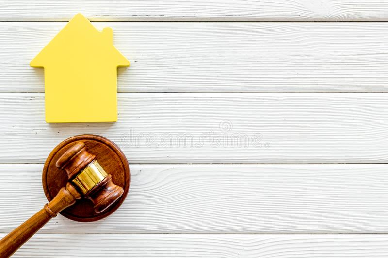 Inheritance of the house concept with figure and gavel on white wooden background top view space for text. Inheritance of the house concept with house figure and stock photo