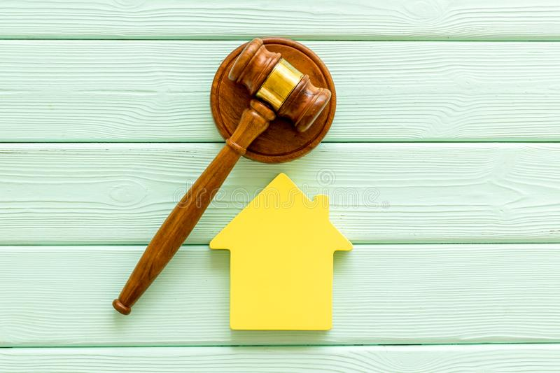 Inheritance of the house concept with figure and gavel on mint green wooden background top view. Inheritance of the house concept with house figure and inscribed royalty free stock photos