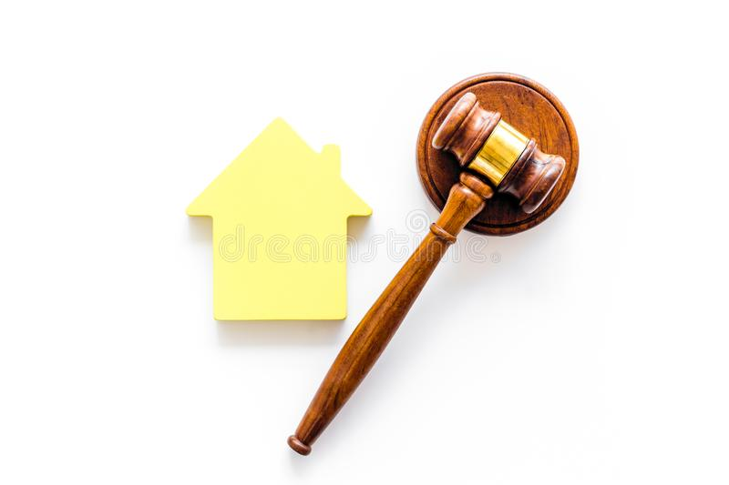 Inheritance of the house concept with figure and gavel on white background top view. Inheritance of the house concept with house figure and inscribed gavel on stock photos
