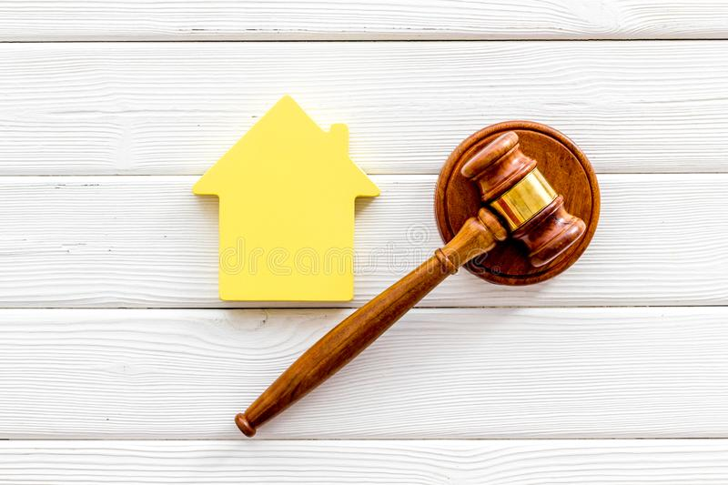 Inheritance of the house concept with figure and gavel on white wooden background top view. Inheritance of the house concept with house figure and inscribed royalty free stock photos