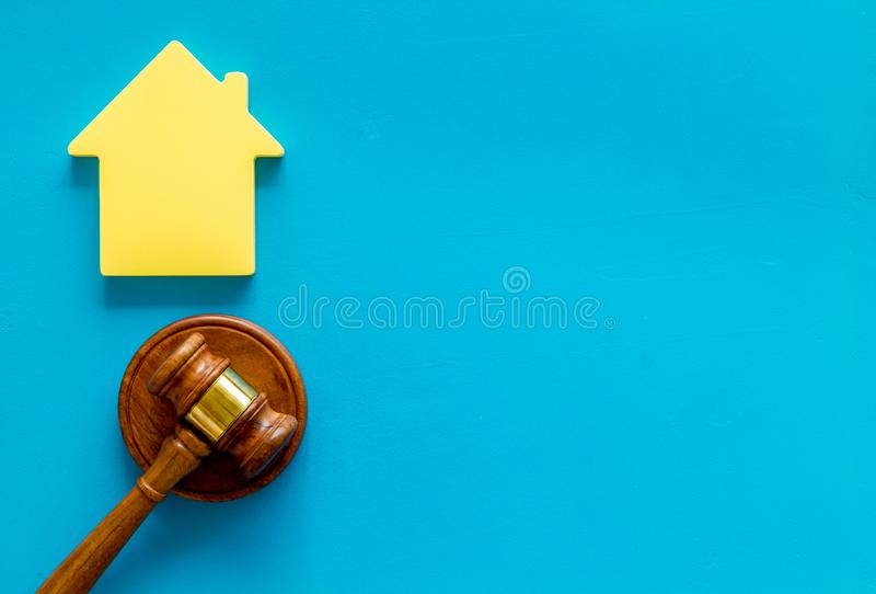 Inheritance of the house concept with figure and gavel on blue background top view space for text. Inheritance of the house concept with house figure and stock photo