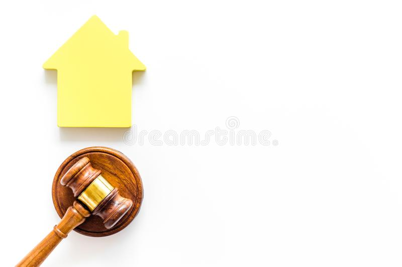 Inheritance of the house concept with figure and gavel on white background top view space for text. Inheritance of the house concept with house figure and stock photo