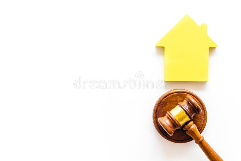 Inheritance of the house concept with figure and gavel on white background top view space for text. Inheritance of the house concept with house figure and stock photography