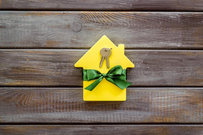 Inheritance house with figure and keys on wooden background top view.  royalty free stock photo