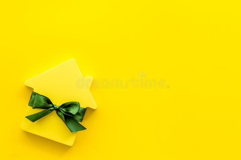 Inheritance house with figure on yellow background top view mockup.  stock photos