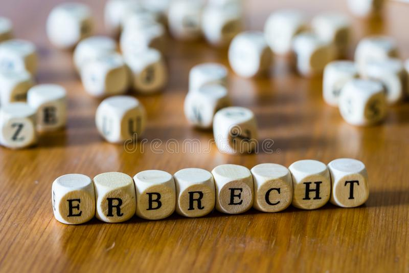 Inheritance right with wooden cubes written in german royalty free stock photos