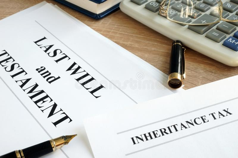 Inheritance tax and last will and testament on a desk. royalty free stock image