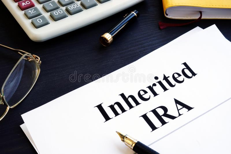 Inherited IRA documents on a table. Retirement plan royalty free stock photos