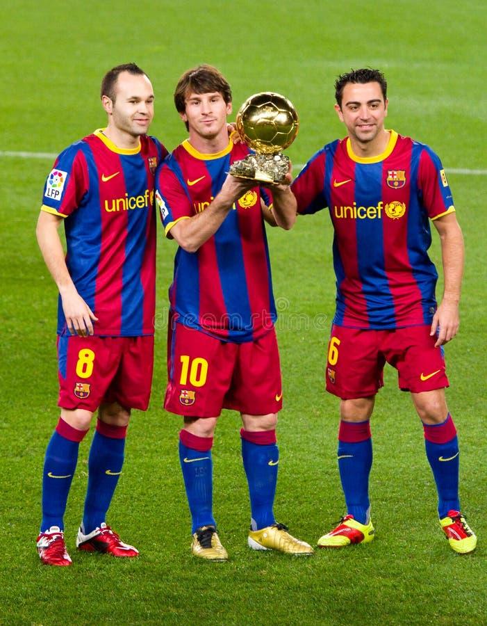 Iniesta, Messi en Xavi met Gouden Bal royalty-vrije stock afbeeldingen