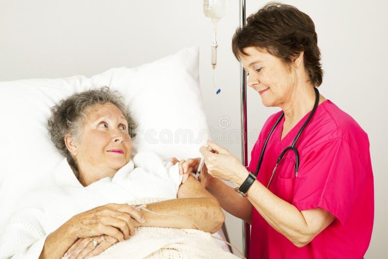 Iniezione dall'infermiera fotografie stock