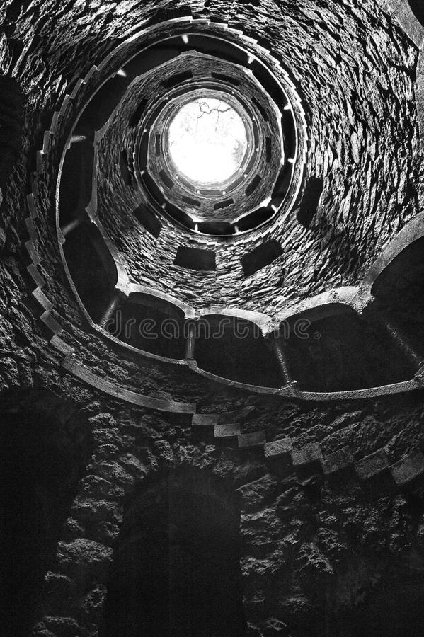 The Initiation well of Quinta da Regaleira in Sintra, Portugal in black and white , downside view. stock images
