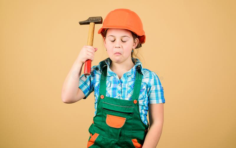 Initiative child girl hard hat helmet builder worker. Tools to improve yourself. Child care development. Builder. Engineer architect. Future profession. Kid royalty free stock images
