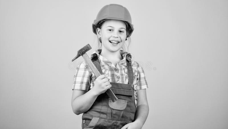 Initiative child girl hard hat helmet builder worker. Tools to improve yourself. Child care development. Future. Profession. Builder engineer architect. Kid royalty free stock photos