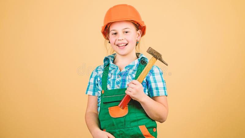 Initiative child girl hard hat helmet builder worker. Tools to improve yourself. Child care development. Future. Profession. Builder engineer architect. Kid stock photography