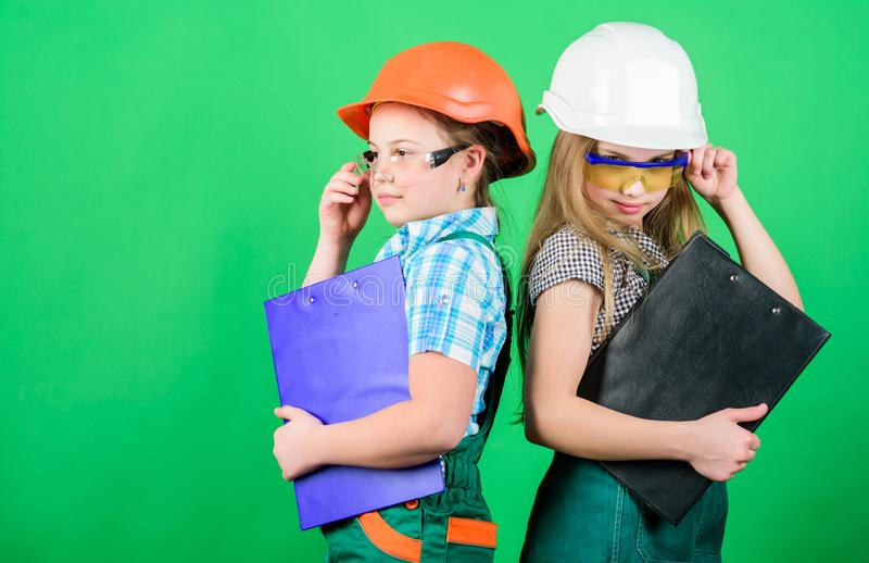 Initiative children girls provide renovation their room green background. Child care. Renovation plan. Home improvement stock images