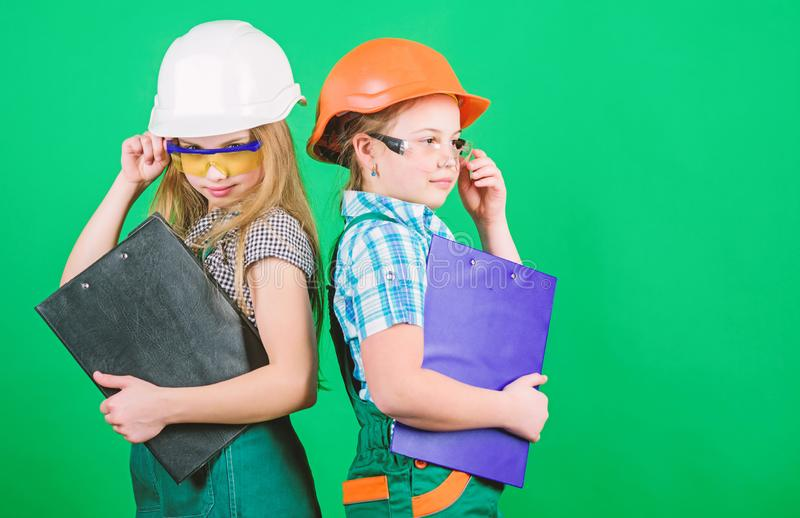 Initiative children girls provide renovation their room green background. Child care. Renovation plan. Home improvement. Builder engineer architect. Future royalty free stock photos
