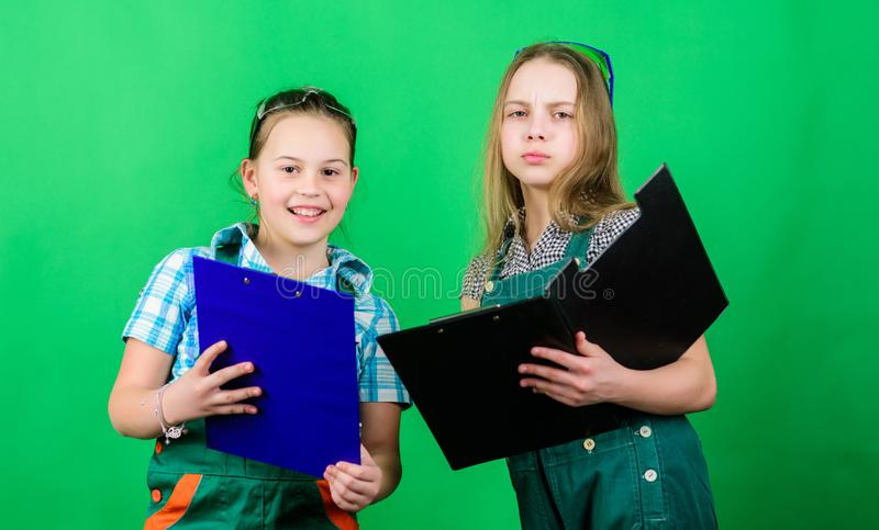Initiative children girls provide renovation their room green background. Child care. Renovation plan. Builder engineer. Architect. According to plan. Future royalty free stock photography