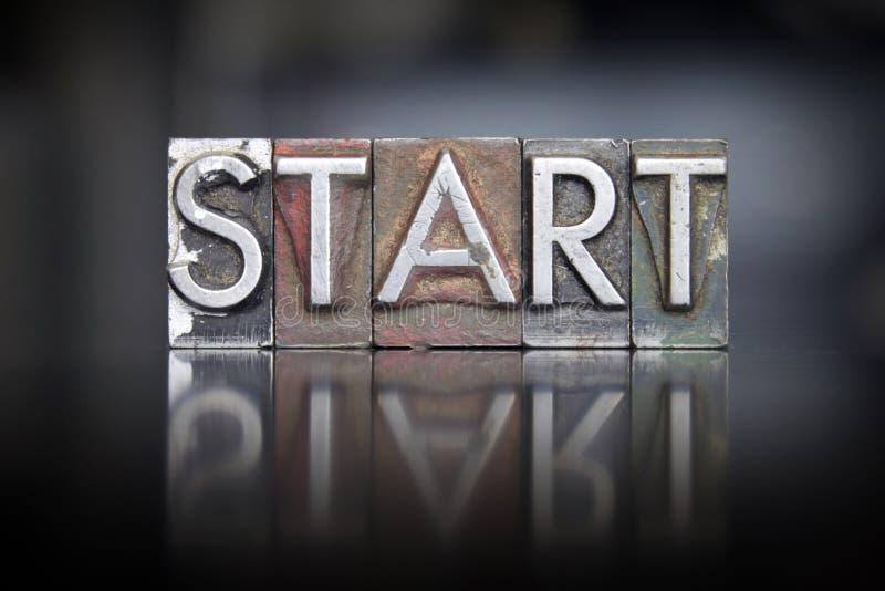 Inizi lo scritto tipografico fotografia stock