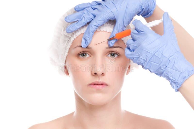 Injeção cosmética do botox na face fotos de stock royalty free