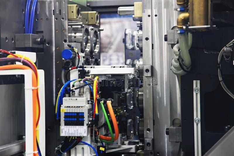 Injectie het vormen machine stock afbeelding