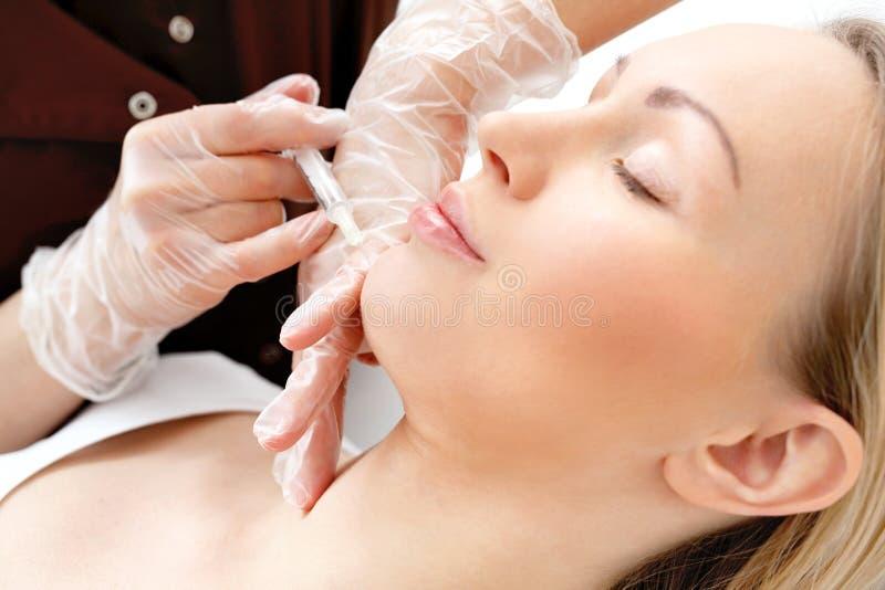 Injectie van botox stock foto's