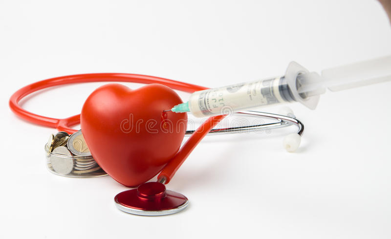 Injecting money. Helth-care cost money coins and bills with a red stethoscope and blood drop royalty free stock image