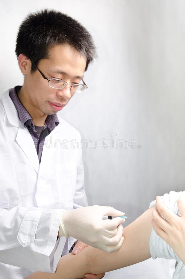 Injecting vaccination royalty free stock image