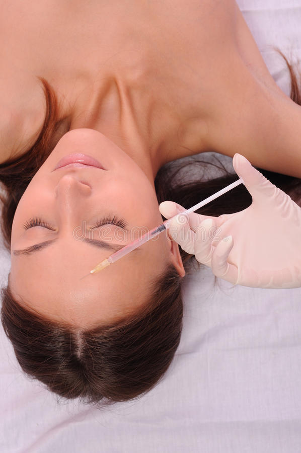 Injection. Botox or hyaluronic acid injection royalty free stock photo