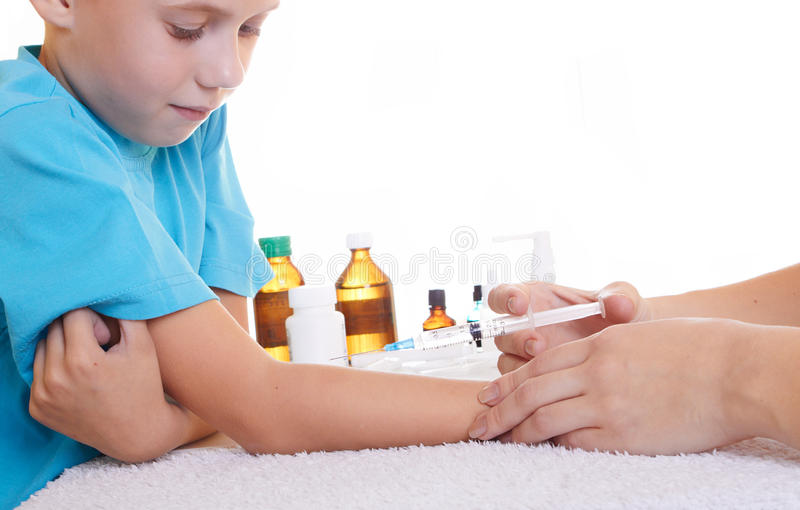 The injection. A doctor giving a child an injection stock image