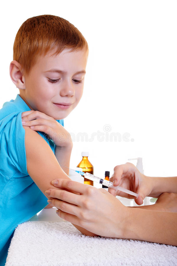 Injection. A doctor giving a child an injection stock photo