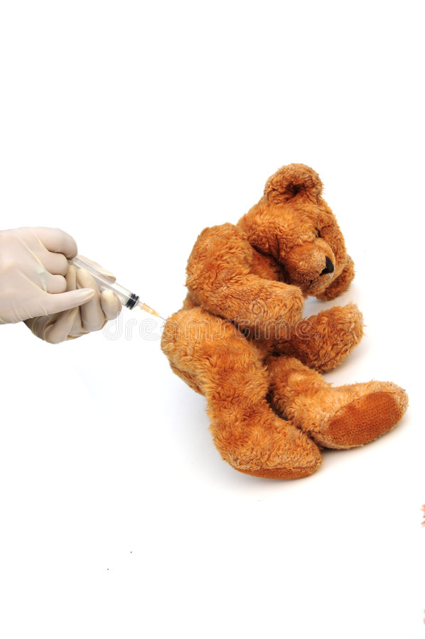 Injection. Shot of a bear having an injection on white royalty free stock photo